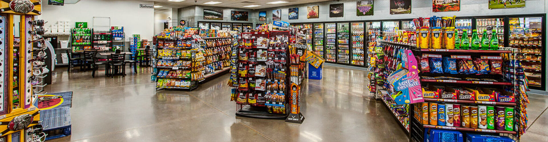 inside the convenience store with fully stocked shelves of food and drinks